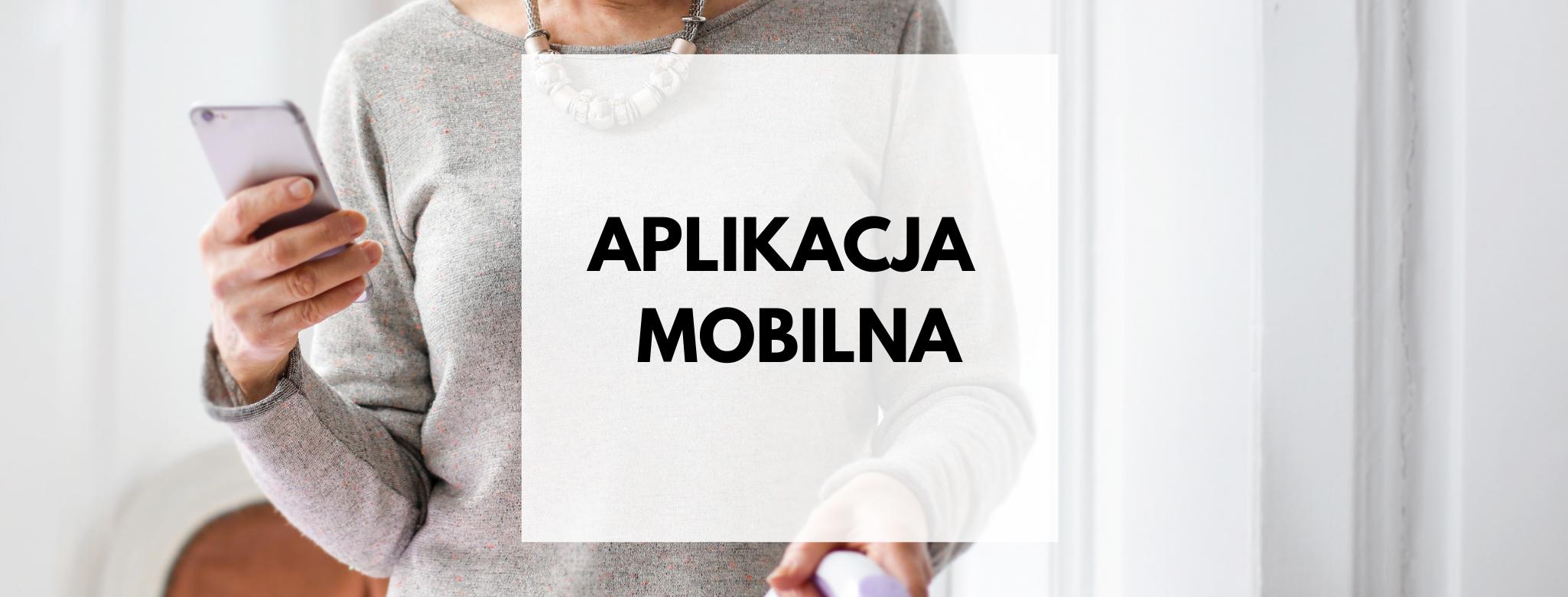 nagłówek graficzny o treści: aplikacja mobilna. Grafika w tle: kobieta w sweterku i naszyjniku trzymająca w dłoni smartfon.